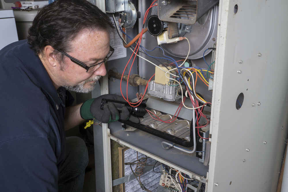 "alt=""picture of a Rheem gas furnace, which last a long time, but sometimes needs attention from the pros at TNT Heating and cooling, serving the residential furnace repair needs of Novi, Northville, and South Lyon MI since 2017"""